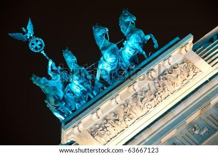 detail of quadriga on Brandenburg Gate at night, Berlin, Germany - stock photo