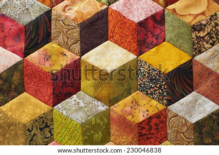 Detail of quilt sewn from pieces as diamonds - stock photo
