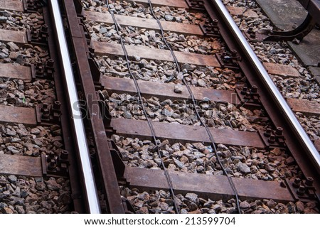Detail of Railway railroad tracks for trains background - stock photo