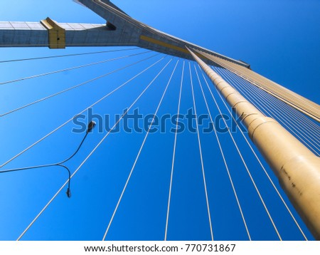 Detail of Rama 8 bridge that spans the Chao Phraya river in Bangkok, Thailand. Cables and pylons makes for an abstract picture.
