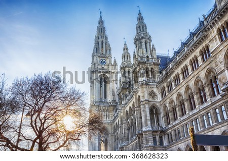 detail of Rathaus of Vienna during winter Christmas market, winter sun
