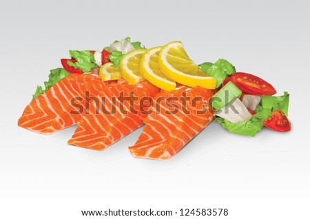 detail of raw salmon fillet on a white background - stock photo