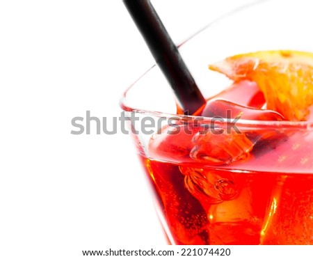 detail of red cocktail with ice cubes and straw on white background, with space for text