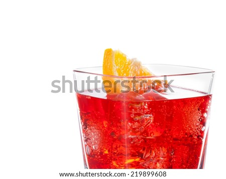 detail of red cocktail with orange slice isolated on white background with space for text - stock photo