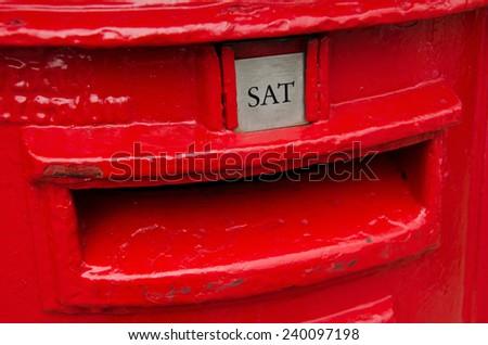 Detail of red metal british post box. - stock photo