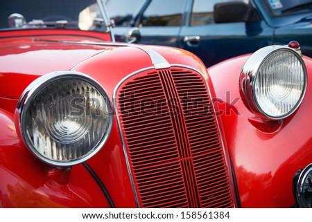 detail of red veteran car - stock photo