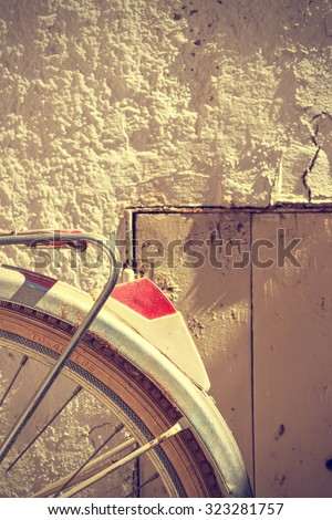 Detail of retro bicycle wheel. It looks part of the rear fender and the brake. Vintage style. Vertical image.