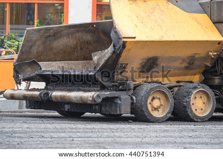 detail of road roller on road