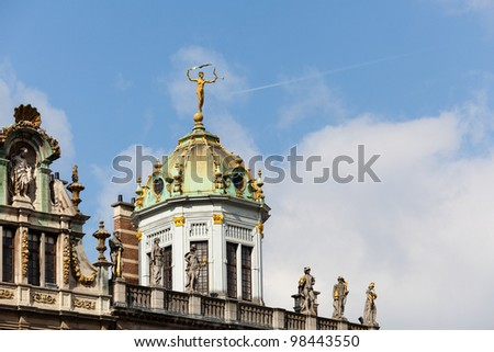 Detail of roof and gold statues on roof of Maison du Roi d Espagne in Grand Place Brussels - stock photo