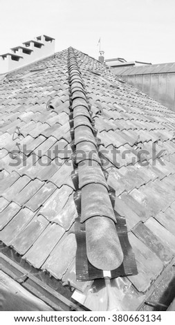 Detail of roof construction in a building site in black and white