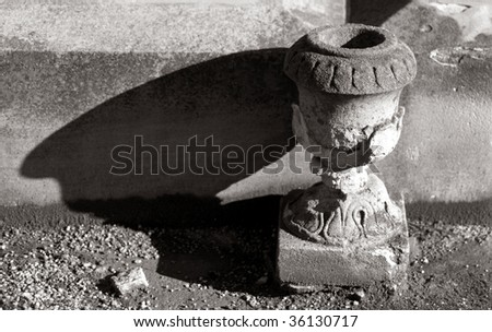 Detail of sandstone  flower pot or urn grave marker in cemetery