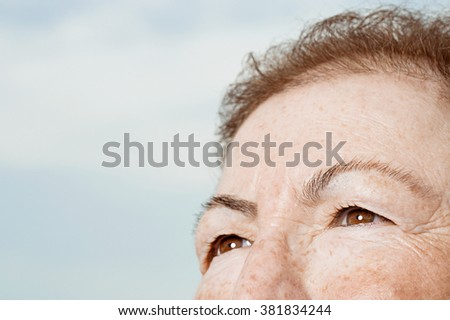 Detail of senior woman's face - stock photo