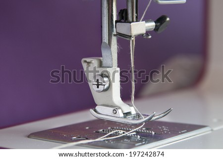 Detail of sewing machine and sewing accessories - stock photo