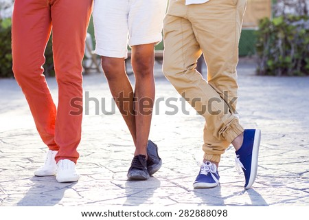 Detail of shoe-wear of a group of three young male - stock photo