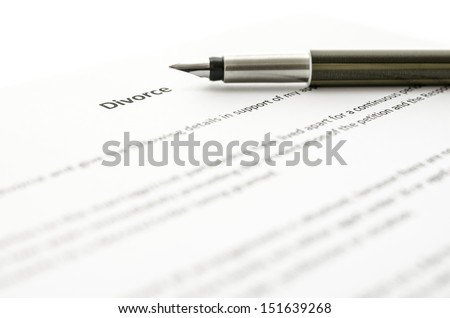 Detail of signing divorce papers. - stock photo