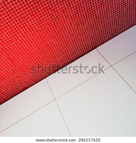 Detail of simple interior with red tiled wall. - stock photo