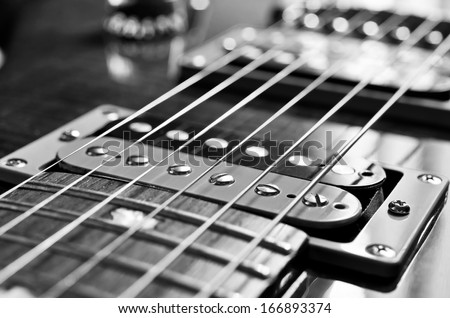 Detail of six-string electric guitar closeup, selective focus.Processed with vintage style. - stock photo
