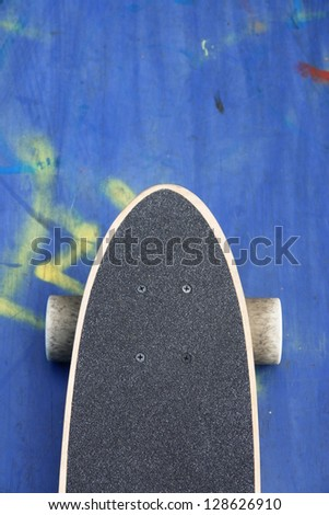 Detail of skateboard on the ground - stock photo