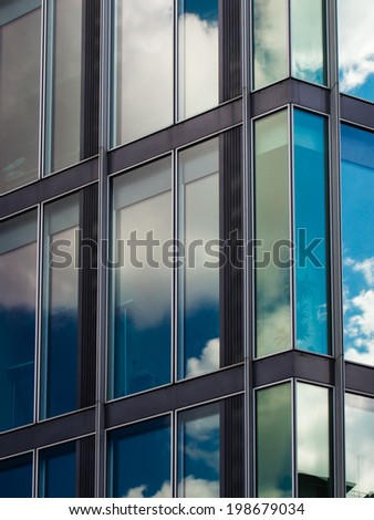 Detail of sky reflection in a modern glass facade, Frankfurt, Germany Fascinating modern architecture in one of the most dynamic business environments in Europe - stock photo