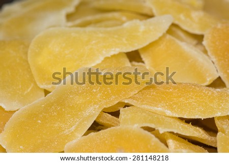 Detail of slices of yellow dried mango on sale at fruit Market