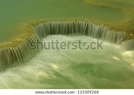 Detail of small waterfall - stock photo