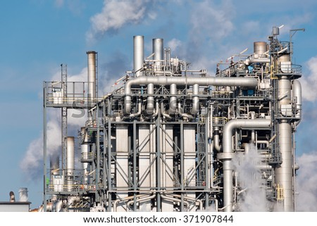 detail of smoking chimneys of a petrochemical factory in an oil refinery