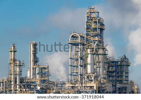 Detail of smoking chimneys of a plastic manufacturing factory - stock photo