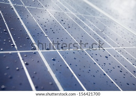 Detail of solar panel with rainy drops on it - stock photo