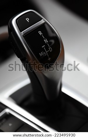 Detail of some black buttons in a car.