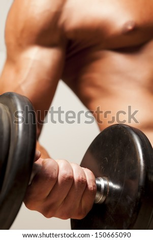 detail of some strong male hands that exercise weightlifting - stock photo