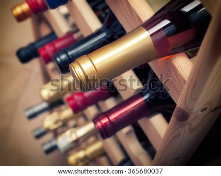 Detail of sorted wine bottles in some winery.