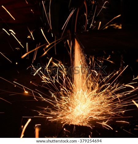 Detail of sparks (worker cutting metal with blade in factory) as abstract background - stock photo