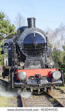 detail of steamed train locomotive in la speiza - stock photo