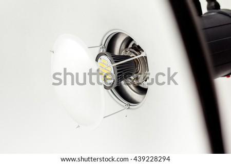 detail of studio lighting flash - beauty dish closeup isolated on white - stock photo