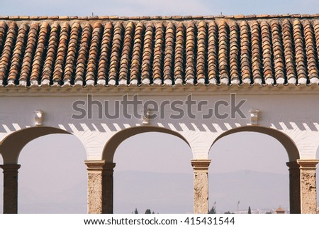 """Detail of the arched colonnade of the Palacio de Generalife (""""Architect's Garden"""") inside the Alhambra, Granada (Spain) - stock photo"""