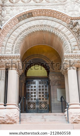 Detail of the architecture of the old city hall in Toronto: a door and a romaneque revival arch. - stock photo