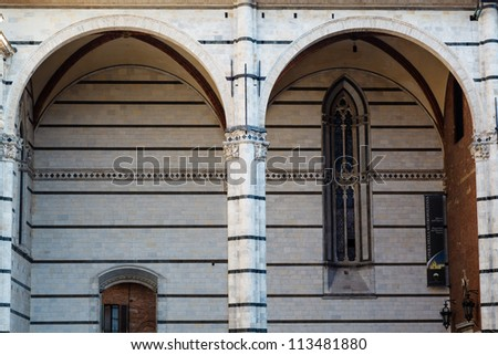 Detail of the Beautiful and Rich Facade of the Cathedral of Siena, Tuscany, Italy - stock photo