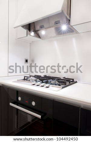 Detail of the black kitchen with the open hood - stock photo