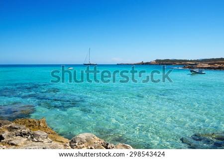 detail of the clear seawater at Cala Conta beach in San Antonio, Ibiza Island, Spain - stock photo