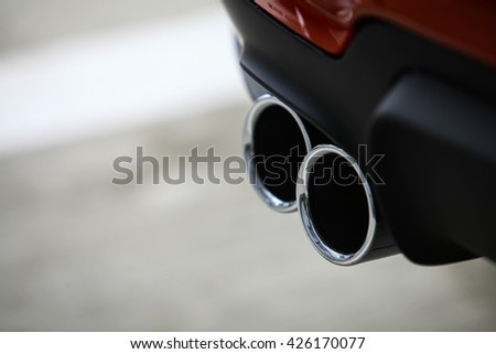 Detail of the double exhaust of a car