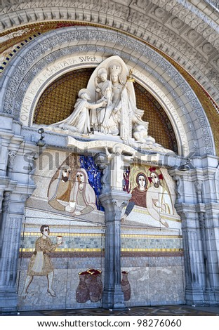 Detail of the entrance of the Basilica of Our Lady of the Rosary of Lourdes, France - stock photo