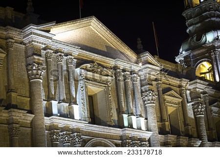 Detail of the facade of the Basilica Cathedral on Plaza de Armas in Arequipa in Southern Peru photographed at night. The historic city center of Arequipa is an UNESCO World Cultural Heritage Site.  - stock photo
