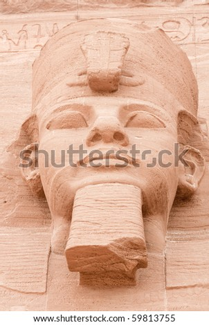 Detail of the face of Ramses II of one of the gigantic statues of Abu Simbel. Built in 1274-1244 BC.  The temples were moved in 1964-1968 to the present site. - stock photo