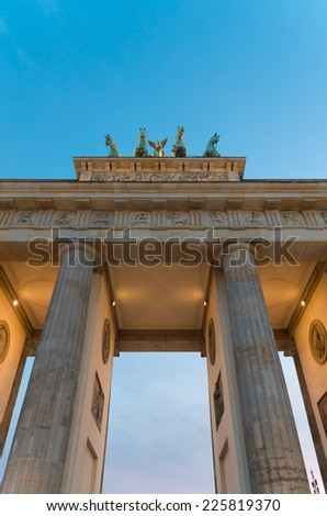 detail of the famous brandenburg gate in berlin at sunset - stock photo