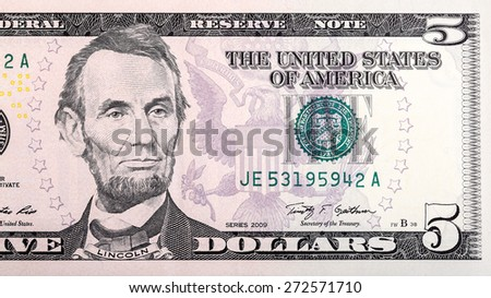 Detail of the five U.S. dollar bill close-up. - stock photo