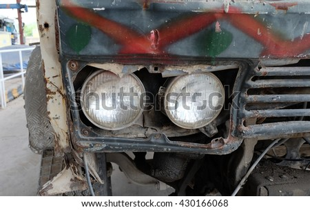 Detail of the front headlight of an old car - stock photo