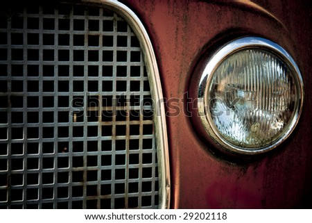 Detail of the front of an abandoned car - stock photo