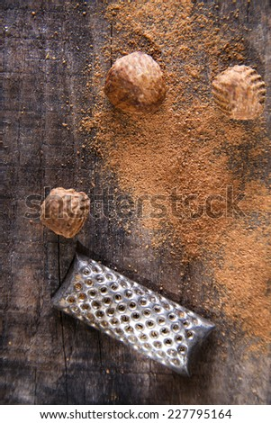 Detail of the grating of nutmeg flavor unique to particular foods and flavors   - stock photo