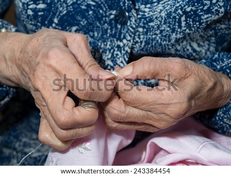 Detail of the hands of a person sewing