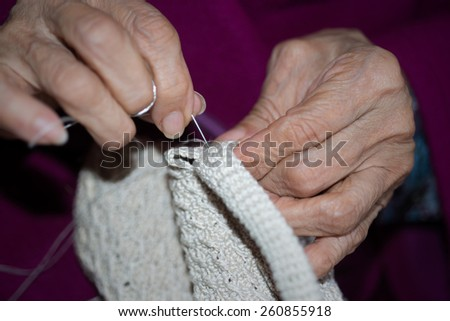 Detail of the hands of a person sewing - stock photo